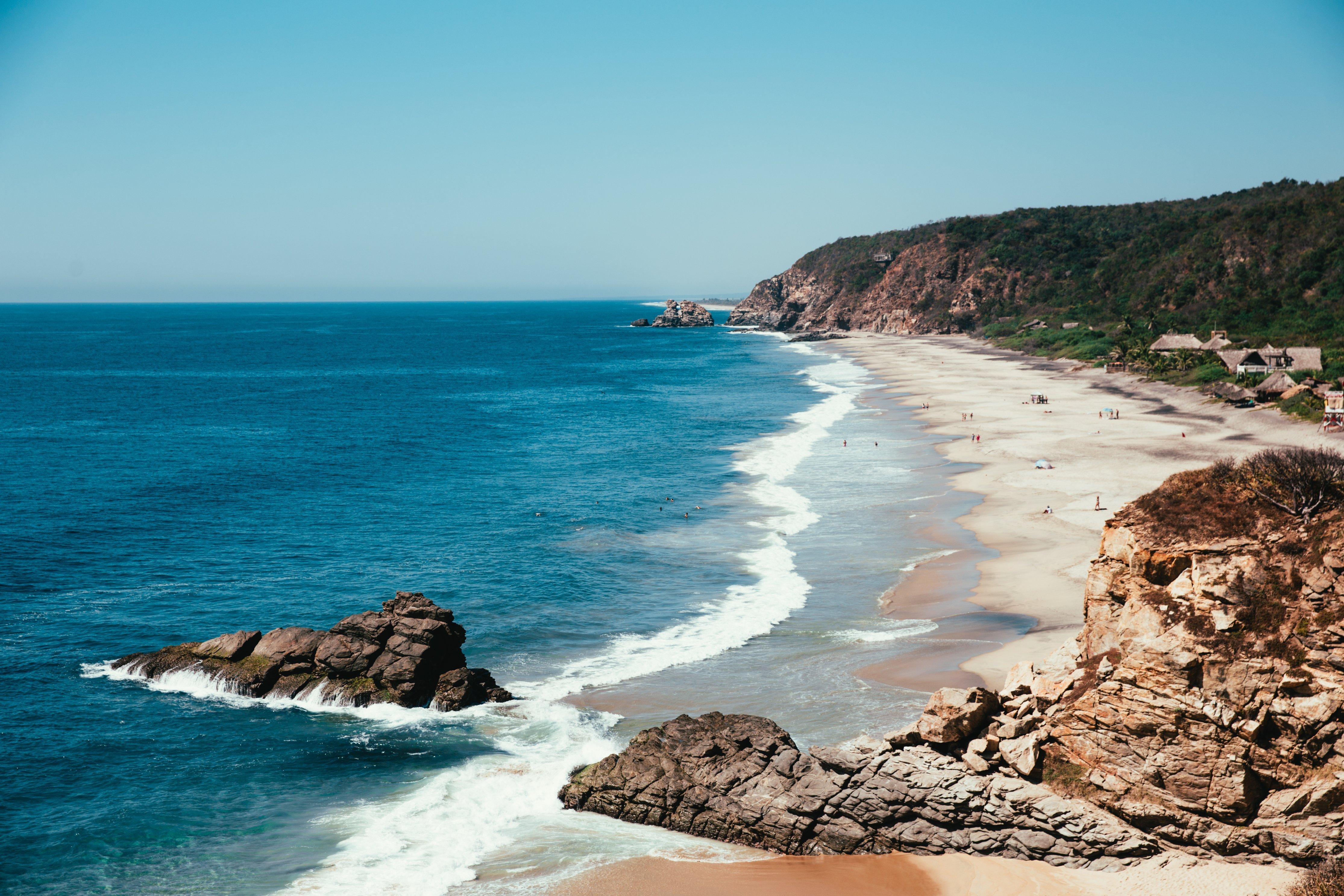 blue-ocean-with-sandy-beach_4460x4460