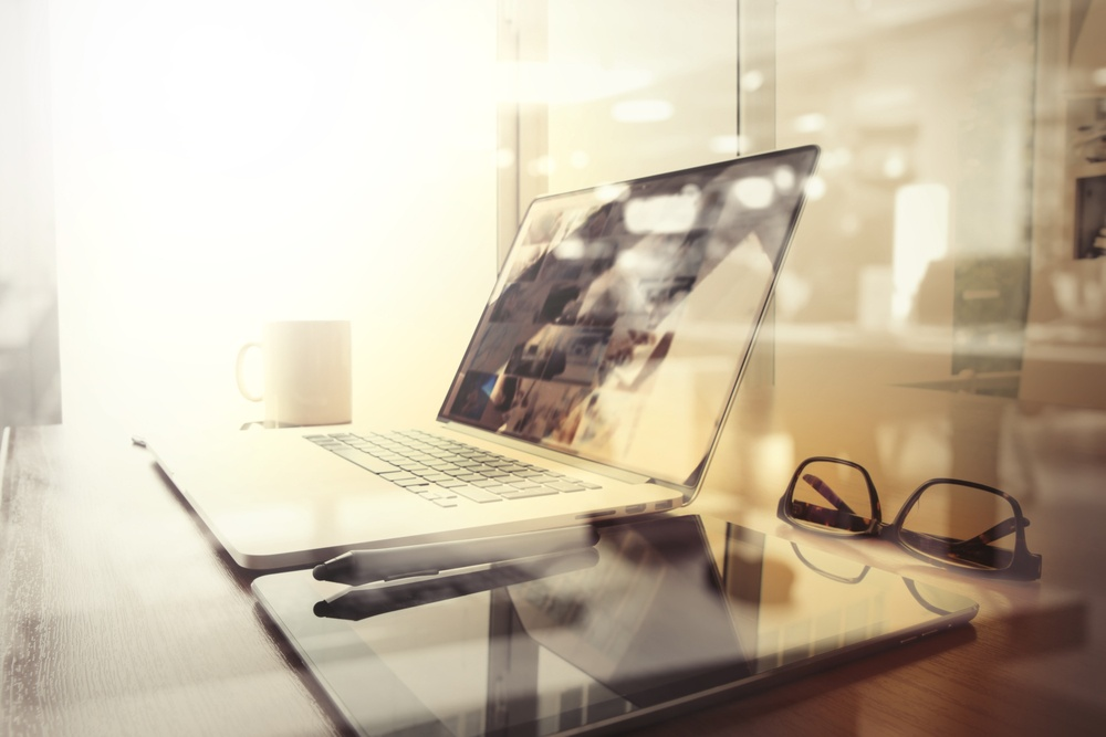 Wakeupdata workplace with laptop and smart phone on wood table and london city blurred background.jpeg